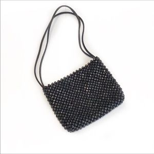 The Sak-Handmade Crocheted Wood Bead Boho Bag